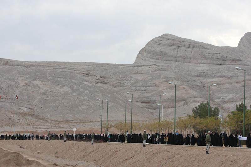 FILE - In this Tuesday, Nov. 15, 2011 file photo, Iranian students form a human chain around the Isfahan Uranium Conversion Facility in support of Iran's nuclear program, just outside the city of Isfahan, 410 kilometers, 255 miles south of the capital Tehran, Iran. While much is known about Iran's nuclear activities from U.N. inspection visits, significant questions remain uncertain, fueling fears of worst-case scenarios and calls for new Mideast military action.(AP Photo/Vahid Salemi, File)