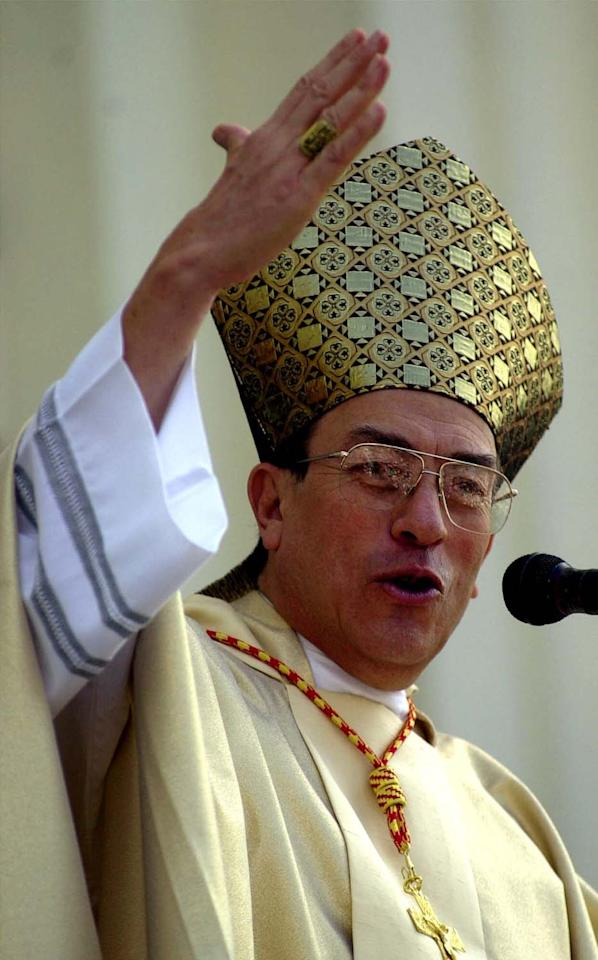 Honduran Cardinal Oscar Andres Rodriguez Madariaga delivers a speech at the Cathedral of San Salvador, El Salvador, Monday, Aug. 6, 2001, during the final day of the Fiestas Agostinas. The weeklong celebration in early August is dedicated to the patron of San Salvador. (AP Photo/Victor Ruiz Caballero)