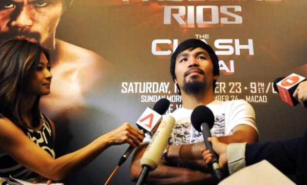 Philippine boxing icon Manny Pacquiao speaks to media at Marina Bay Sands in Singapore on August 2, 2013. Pacquiao is on the Singapore leg of a promotional tour for his November fight in Macau with Brandon Rios. (AFP PHOTO / MOHD FYROL)