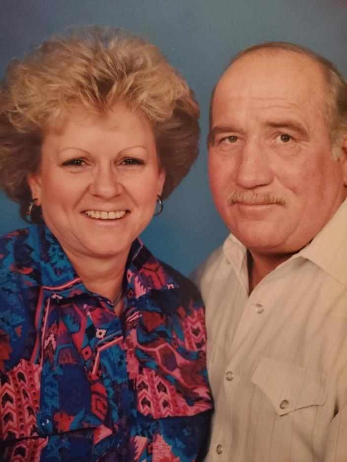A family photo of a couple posing for a portrait