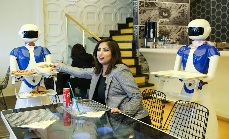 Robot waiters serve food to customers in Istanbul (Getty Images)