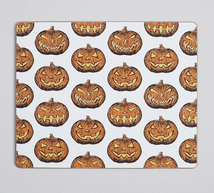 <p>Serve up a scary good dinner with the <span>Jack-O'-Lantern Cork Placemats</span> ($48).</p>