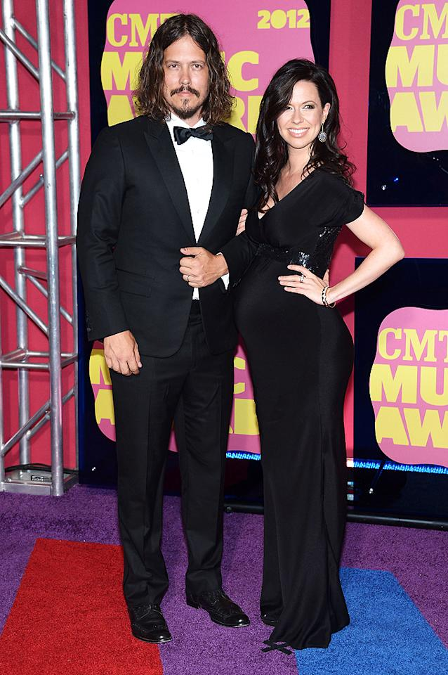 """The duo of John Paul White and Joy Williams, better known as The Civil Wars, were fancy in a sleek tux (for him) and a sophisticated black gown (for a very pregnant her). The two, who are not married to each other but to other people, incidentally, were nominated for three CMT Awards, including two for """"Safe & Sound,"""" their collaboration with Taylor Swift for """"The Hunger Games."""""""