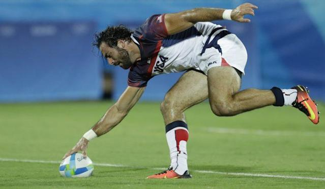 """Patriots safety <a class=""""link rapid-noclick-resp"""" href=""""/olympics/rio-2016/a/1124217/"""" data-ylk=""""slk:Nate Ebner"""">Nate Ebner</a> scored a try in the United States' rugby sevens match on Tuesday (AP)"""