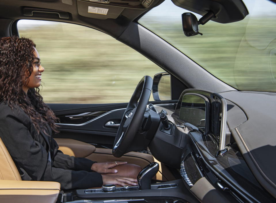 This image provided by General Motors shows the 2021 Cadillac Escalade, an upcoming SUV that features Cadillac's Super Cruise technology. Unlike Tesla's Autopilot, Super Cruise offers a truly hands-free driving experience. (Jessica Lynn Walker/General Motors via AP)