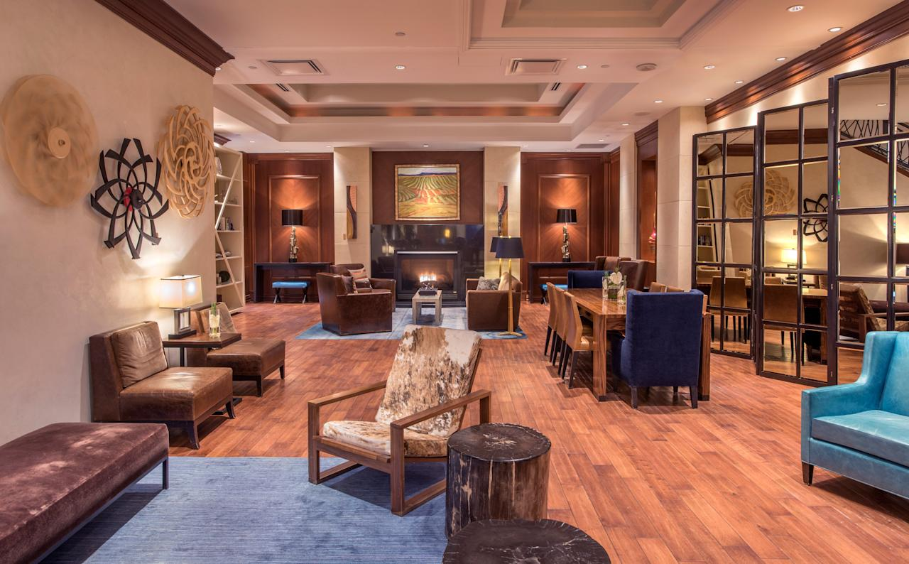 """<p><strong>First impressions?</strong><br> The lobby here shines thanks to warm wooden floors, lavish couches, and a grand staircase that leads to the second floor. Located in the exclusive shopping neighborhood of Cherry Creek North, guests trust the reliable luxury—and standard decorating tropes—of the JW brand.</p> <p><strong>Who else is here?</strong><br> Business travelers, older couples, and discerning shoppers.</p> <p><strong>How's the check-in process?</strong> Hotel staff have check-in and check-out down pat.</p> <p><strong>And the rooms?</strong><br> Spacious rooms feel like mini-houses, with writing desks, a seating area, and more than 400 square feet. Bold oranges and teals brighten up the decor, even if the furniture is a bit pedestrian.</p> <p><strong>Any amenities of note?</strong><br> Take advantage of pleasant-smelling soap products in the granite and marble four-piece baths, but don't expect much from the mini bar; it's standard. Larger-than-normal guest rooms make the JW Marriott a good option for <a href=""""https://www.cntraveler.com/story/complete-guide-to-family-travel?mbid=synd_yahoo_rss"""">families</a>. Complimentary cribs are available upon request, or you can ask for a king room with a queen-sized sofa sleeper for the kiddos.</p> <p><strong>Bottom line.</strong><br> It's a family-friendly, reliable option in the bustling shopping district of Cherry Creek North.</p>"""