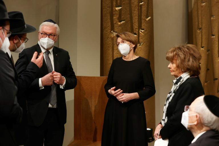 Vice President of the European Jewish Congress and the World Jewish Congress Charlotte Knobloch (with scarf) meets German political leaders and rabbis at a ceremony to complete the Sulzbach Torah Scroll from 1792, rediscovered in 2013 and restored