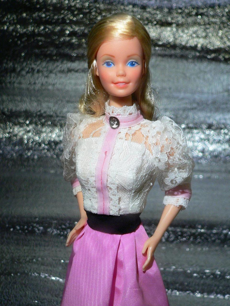 "<p>In contrast, 1982's Angel Face Barbie has a much more subtle look, with a high-necked lace blouse accented with a cameo. </p><p><a href=""https://flic.kr/p/B1EnQZ"" rel=""nofollow noopener"" target=""_blank"" data-ylk=""slk:Flickr photo by Julius Seelbach"" class=""link rapid-noclick-resp""><em>Flickr photo by Julius Seelbach</em></a></p>"