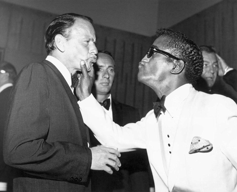 <p>Full of personality, Sammy Davis Jr. and Frank Sinatra are seen joking around in July, 1961.</p>