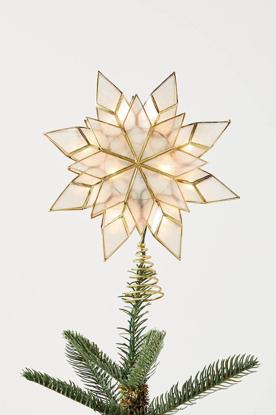 """<p>All of the inspiration is written in the stars with this <a href=""""https://www.popsugar.com/buy/Illuminated-Capiz-Star-Tree-Topper-490440?p_name=Illuminated%20Capiz%20Star%20Tree%20Topper&retailer=anthropologie.com&pid=490440&price=38&evar1=casa%3Aus&evar9=46615300&evar98=https%3A%2F%2Fwww.popsugar.com%2Fhome%2Fphoto-gallery%2F46615300%2Fimage%2F46615310%2FIlluminated-Capiz-Star-Tree-Topper&list1=shopping%2Canthropologie%2Choliday%2Cchristmas%2Cchristmas%20decorations%2Choliday%20decor%2Chome%20shopping&prop13=mobile&pdata=1"""" rel=""""nofollow noopener"""" class=""""link rapid-noclick-resp"""" target=""""_blank"""" data-ylk=""""slk:Illuminated Capiz Star Tree Topper"""">Illuminated Capiz Star Tree Topper</a> ($38).</p>"""