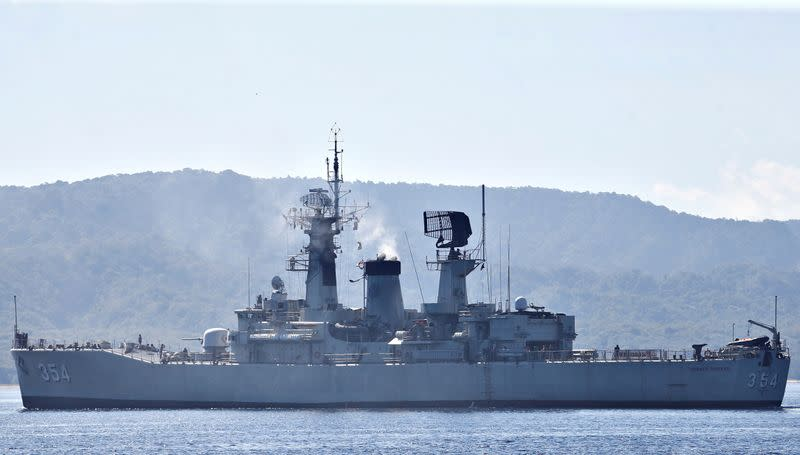 Indonesian Navy's KRI Oswald Siahaan-354 leaves the Tanjung Wangi port as the search continues for the missing KRI Nanggala-402 submarine