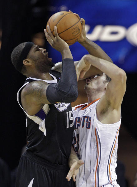 Sacramento Kings' DeMarcus Cousins, left, shoots over Charlotte Bobcats' Byron Mullens during the first half of an NBA basketball game in Charlotte, N.C., Sunday, April 22, 2012. (AP Photo/Chuck Burton)