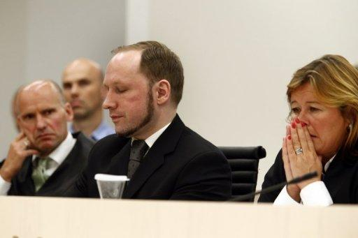 Defender Geir Lippestad (left) and defender Vibeke Hein Baera (right) sit with Anders Behring Breivik as an Oslo Court finds him criminally responsible for his actions, sentencing him to 21 years in jail, on Friday
