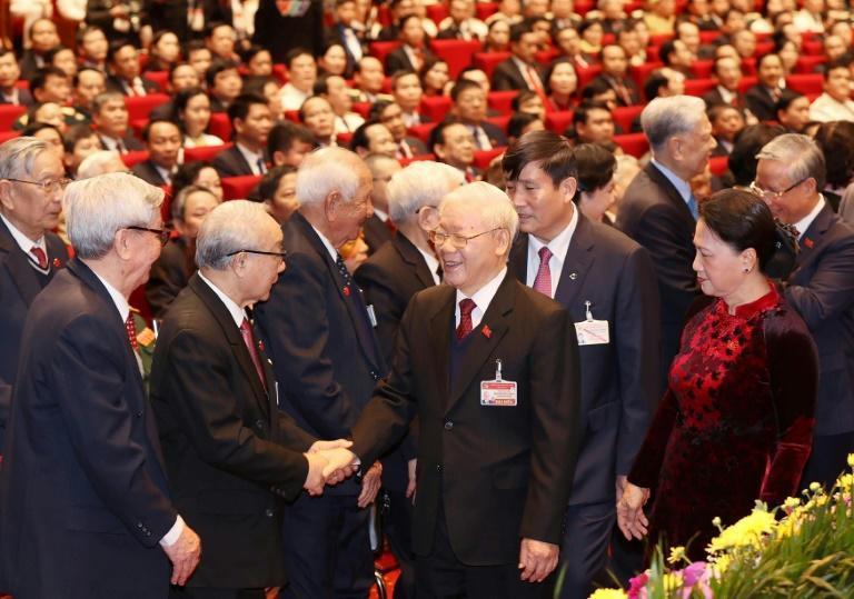 Analysts say Nguyen Phu Trong (C) is vying for another term as general secretary