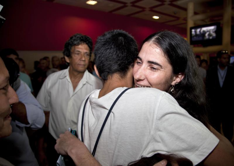 Cuban dissident blogger Yoani Sanchez embraces her son Teo Escobar upon her arrival at the Jose Marti International Airport in Havana, Cuba, Thursday, May 30, 2013. Sanchez is back home after a more than three-month globe-trotting tour that has turned her into the most internationally recognizable face in the island's small dissident community. Sanchez has been on the road since Feb. 17 and visited more than a dozen countries in Europe and the Americas. (AP Photo/Ramon Espinosa)