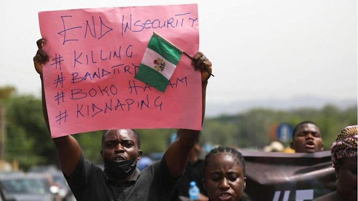 Parents and relatives of a student kidnapped from another school have a placard during a demonstration in Abuja