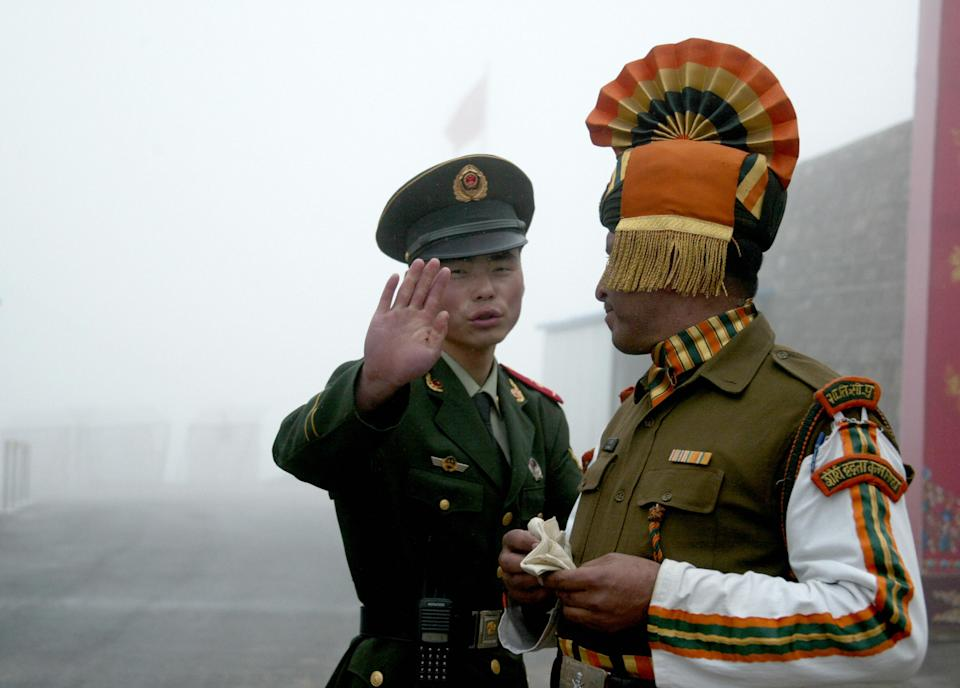 <strong>India, China border flare-up: </strong>File photos of a Chinese soldier gesturing at an Indian soldier on the Chinese side of the ancient Nathu La border crossing between India and China. The two Asian giants have been locked in a tussle that the world feared could flare up further. <br>Meanwhile, China said on May 27 that the situation at the border with India is 'overall stable and controllable'. The comments came in the backdrop of the continuing standoff between the militaries of India and China at the Line of Actual Control. <em>(File photo taken in 2008)</em>