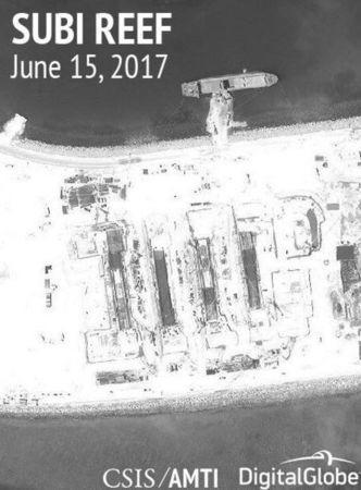 Construction is shown on Subi Reef, in the Spratly Islands, the disputed South China Sea in this June 15, 2017 satellite image released by CSIS Asia Maritime Transparency Initiative at the Center for Strategic and International Studies (CSIS) to Reuters on June 29, 2017. MANDATORY CREDIT CSIS/AMTI DigitalGlobe/Handout via REUTERS