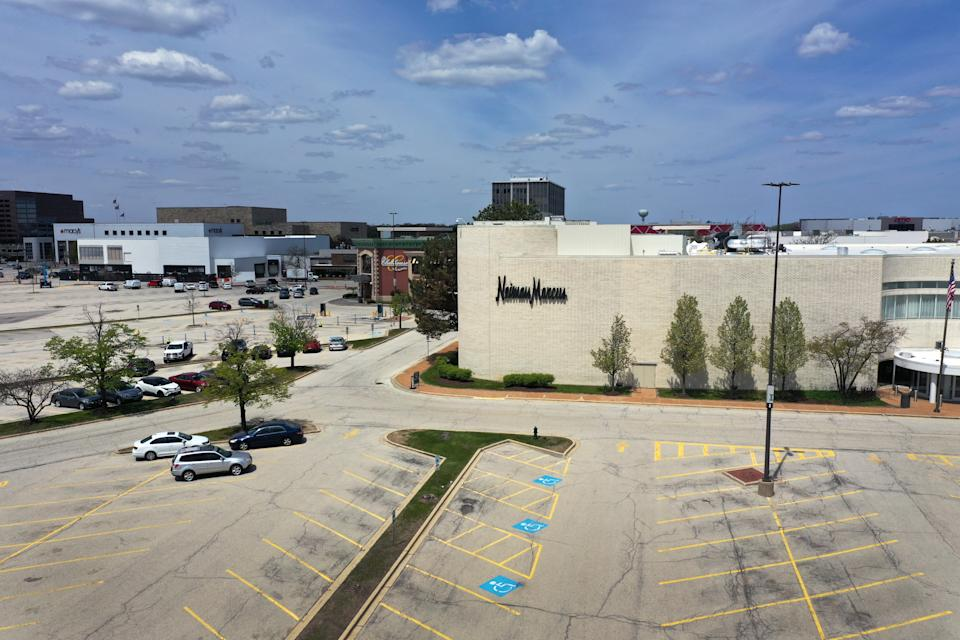 OAK BROOK, ILLINOIS - MAY 07: An aerial view from a drone shows the parking lot is nearly empty outside of a Neiman Marcus store that has been shuttered by the COVID-19 pandemic at Oak Brook Center shopping mall on May 07, 2020 in Oak Brook, Illinois. Neiman Marcus filed for bankruptcy today, making it the first major retailer to seek bankruptcy protection since the economic collapse brought on by the coronavirus pandemic.  (Photo by Scott Olson/Getty Images)