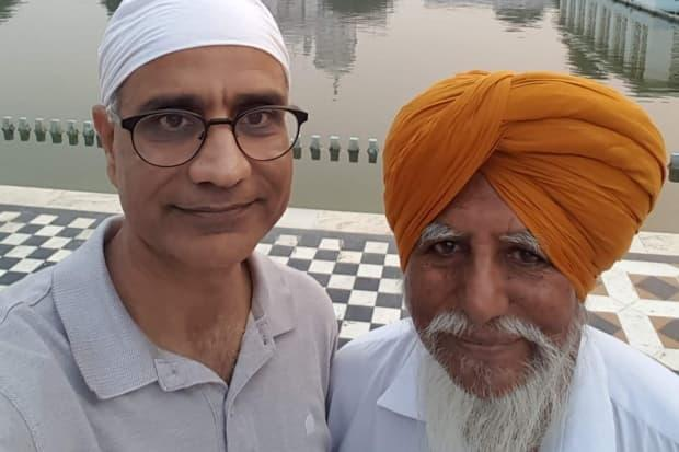 Varinder Bhullar, left, with his father during a previous trip to India. Bhullar is using his social media presence to deliver important information to people in the country, which is currently in the grips of a second wave of COVID-19 infections. (Submitted by Varinder Bhullar - image credit)