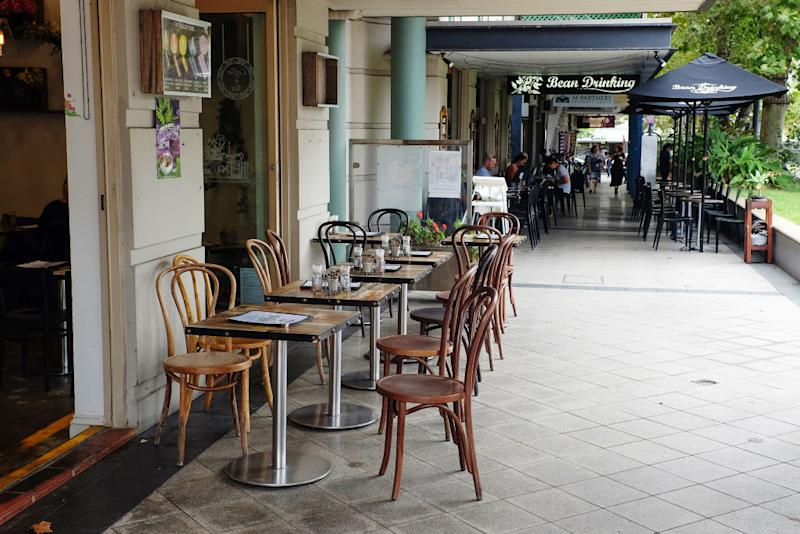 Empty tables are seen at a cafe during lunch time in the suburbs of Crows Nest in Sydney, Australia, on Wednesday, March 4, 2020. Australia has been hard-hit by coronavirus. (Photographer: Brendon Thorne/Bloomberg)