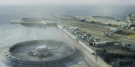 Military VTOL aircraft crowd the decks of the flying Helicarrier from the Avengers film