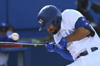 Toronto Blue Jays' Marcus Semien ducks away from an inside pitch in the fourth inning of a baseball game against the Minnesota Twins in Toronto on Saturday, Sept. 18, 2021. (Jon Blacker/The Canadian Press via AP)