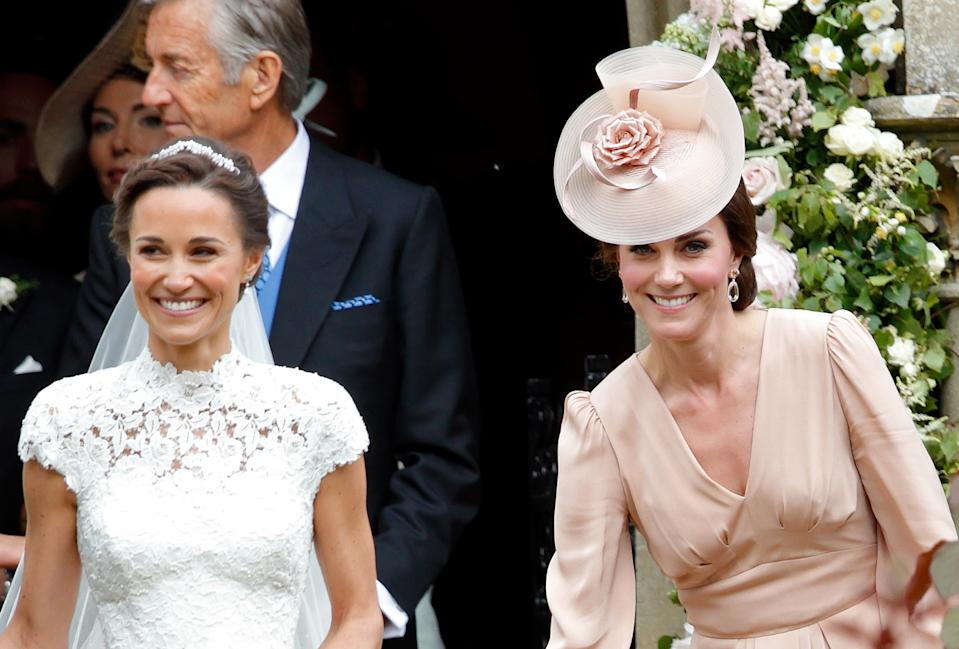 ENGLEFIELD GREEN, UNITED KINGDOM - MAY 20: (EMBARGOED FOR PUBLICATION IN UK NEWSPAPERS UNTIL 48 HOURS AFTER CREATE DATE AND TIME) Pippa Middleton leaves St Mark's Church accompanied by Catherine, Duchess of Cambridge after her wedding on May 20, 2017 in Englefield Green, England. (Photo by Max Mumby/Indigo/Getty Images)