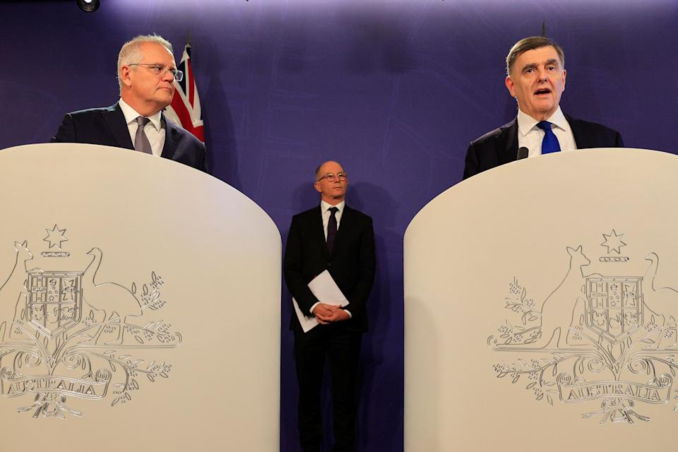 Australian prime minister Scott Morrison (left) is joined by Dr Brendan Murphy, secretary of the department of health (right) and professor Paul Kelly, chief medical Officer during a press conference in Sydney, Australia. (Photo: Mark Evans/Getty Images)