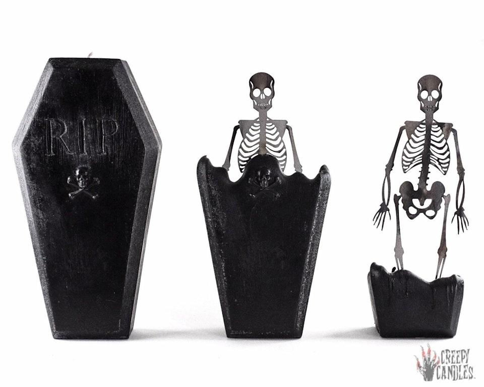 """<p>Standing nearly a foot tall, this <span>Coffin Skeleton Candle</span> ($35) from Etsy takes <a class=""""link rapid-noclick-resp"""" href=""""https://www.popsugar.com/Halloween"""" rel=""""nofollow noopener"""" target=""""_blank"""" data-ylk=""""slk:Halloween"""">Halloween</a> candles to a whole other level. As the wick burns, the coffin candle melts, revealing a metal skeleton. Spooky!</p>"""