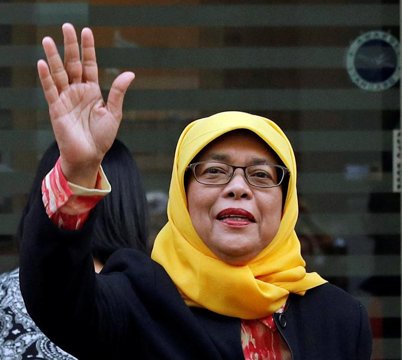 Former speaker of Singapore's parliament, Halimah Yacob, arrives at the Elections Department after she was given the certificate of eligibility to contest the election by the Presidential Elections Committee in Singapore September 11, 2017.
