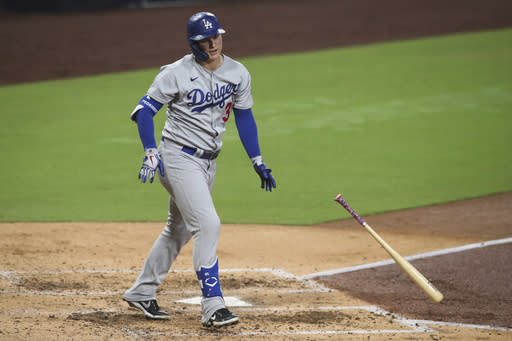 Los Angeles Dodgers' Joc Pederson tosses his bat after hitting the ball to the wall in center field for an out in the sixth inning of a baseball game against the San Diego Padres, Monday, Sept. 14, 2020, in San Diego. (AP Photo/Derrick Tuskan)