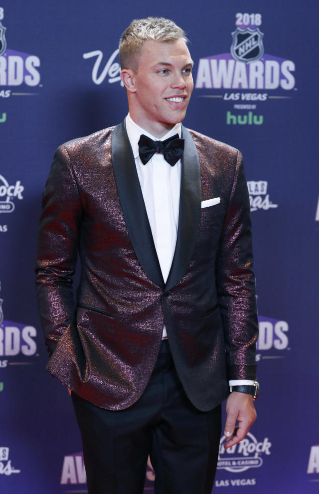 New Jersey Devils' Taylor Hall poses on the red carpet before the NHL Awards, Wednesday, June 20, 2018, in Las Vegas. (AP Photo/John Locher)