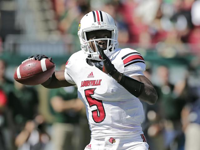 Louisville quarterback Teddy Bridgewater (5) looks for a receiver against South Florida during the first quarter of an NCAA college football game Saturday, Oct. 26, 2013, in Tampa, Fla. (AP Photo/Chris O'Meara)