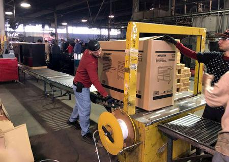 FILE PHOTO: Employees seen working inside the Metal Box International toolbox factory in Franklin Park