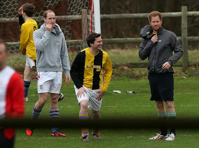 Prince William and Prince Harry play in the annual Sandringham Football Match, December 2015.