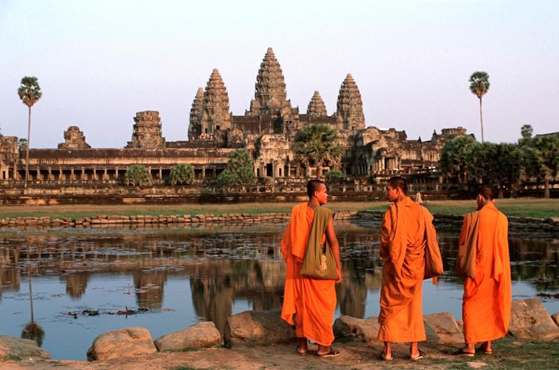 Monks at Angkor Wat temple in Cambodia - © 2001 Peter Charlesworth