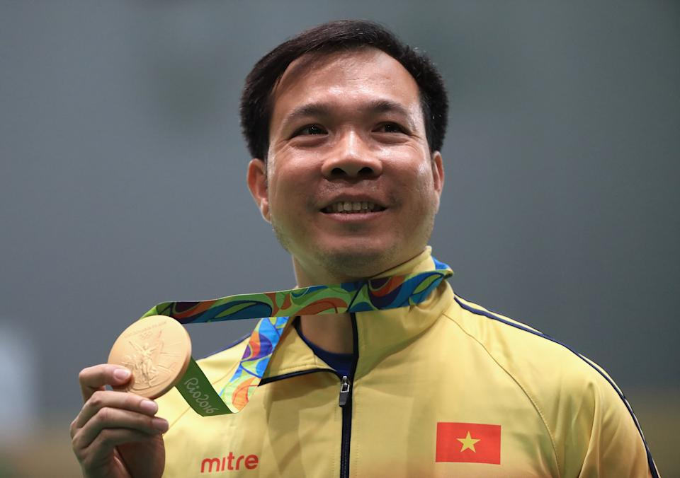 Vietnam shooter Hoang Xuan Vinh is all smiles after winning his country's first Olympic gold medal in the men's 10m air pistol at the 2016 Rio de Janeiro Games.
