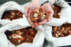 Woman collects £35,000 in small change from toilets