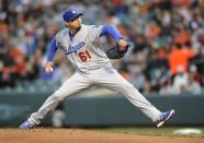 Los Angeles Dodgers starting pitcher Josh Beckett delivers against the Baltimore Orioles in the first inning of the second baseball game of a doubleheader, Saturday, April 20, 2013, in Baltimore. (AP Photo/Gail Burton)