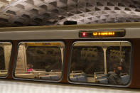 A passenger sits on a train at Metro Center station, Friday, April 23, 2021, in Washington. As President Joe Biden urges more federal spending for public transportation, transit agencies decimated by COVID-19 are struggling with a new uncertainty: how to win passengers back. (AP Photo/Patrick Semansky)