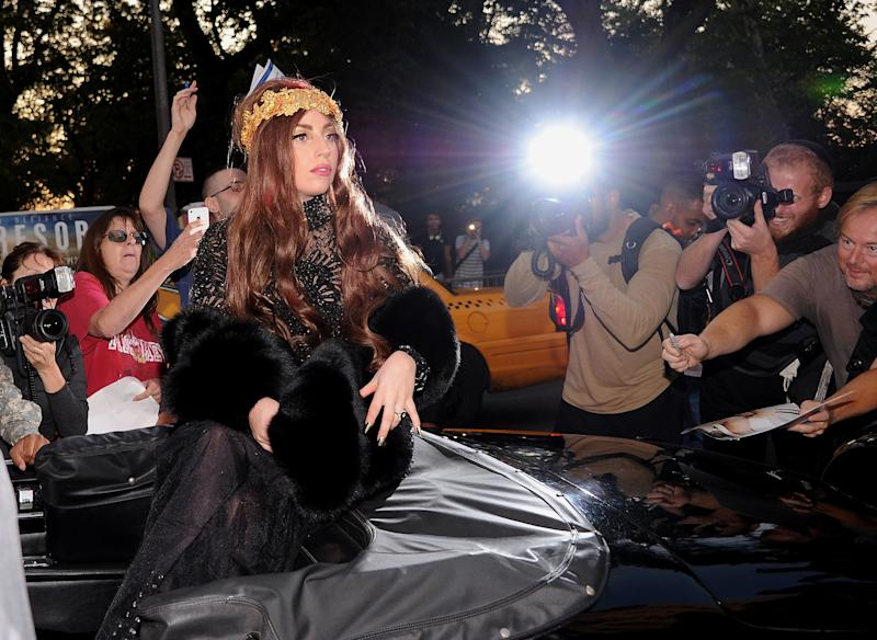 """Singer Lady Gaga arrives at a """"Lady Gaga Fame"""" fragrance launch event at the Guggenheim Museum on Thursday, Sept. 13, 2012 in New York. The black tie masquerade event will feature a performance art piece by Lady Gaga, """"Sleeping with Gaga."""" The film for """"Lady Gaga Fame"""", directed by Steven Klein, will also be unveiled during the evening. (Photo by Evan Agostini/Invision/AP)"""