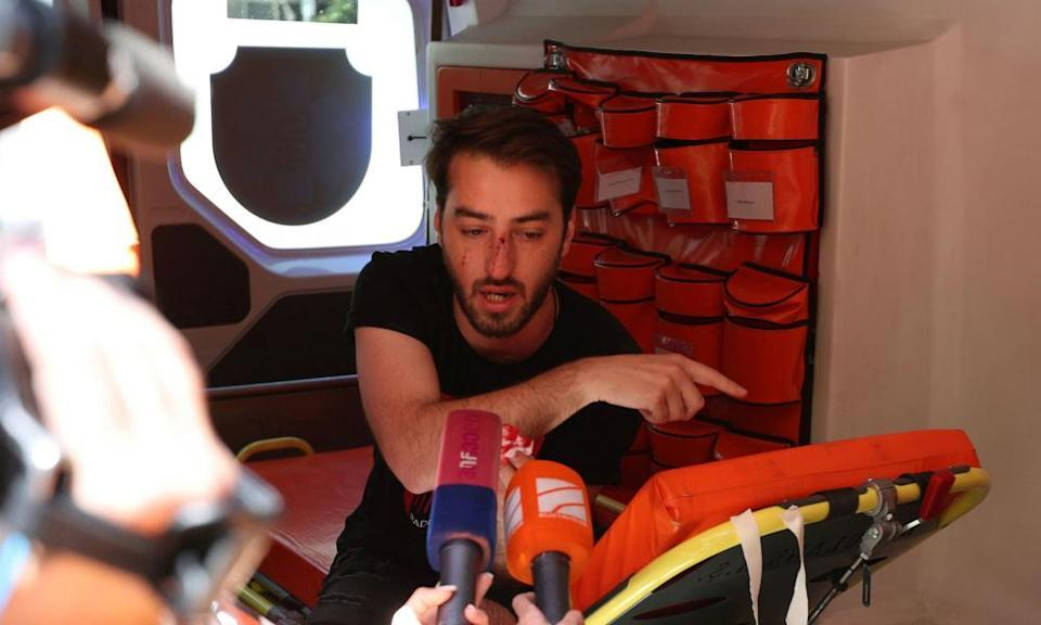 An injured journalist speaks to the media inside an ambulance in Tbilisi.