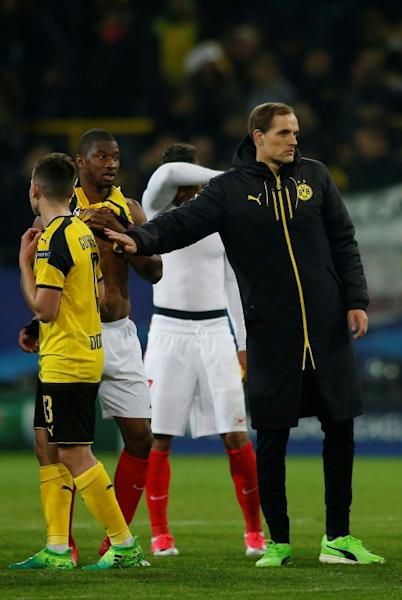 Dortmund's head coach Thomas Tuchel (R) and players react after losing their UEFA Champions League quarter-final 1st leg match against Monaco, in Dortmund, on April 12, 2017