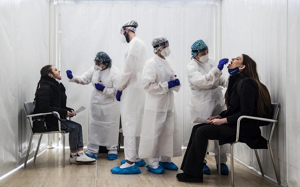 Healthcare professionals perform Covid-19 swab tests on students of the University 'La Sapienza' of Rome - ANGELO CARCONI/EPA-EFE/Shutterstock