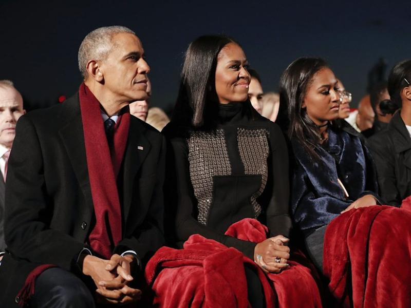 From left: former President Barack Obama, daughter Sasha Obama and former First Lady Michelle Obama in December 2016 | AP Photo/Pablo Martinez Monsivais