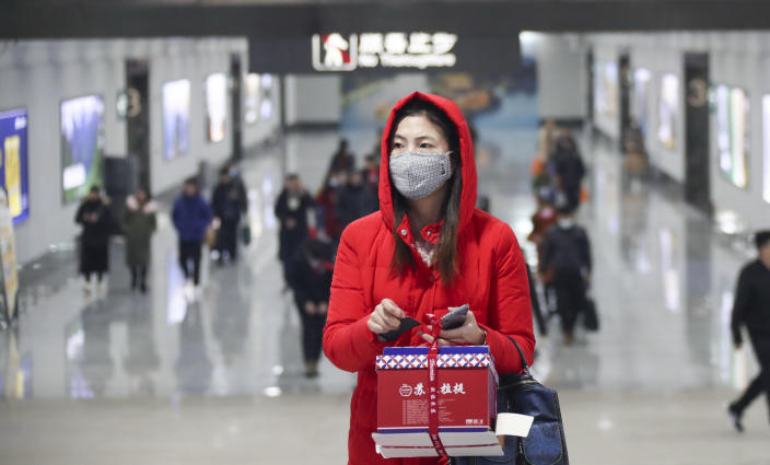 Chinese passengers wearing face masks for the prevention of the new coronavirus are seen at Huai'an East Railway Station during the Spring Festival travel rush ahead of the Chinese New Year in Huai'an City, east China's Jiangsu Province on January 23rd, 2020. (Photo by Zhao Qirui / Costfoto/Sipa USA)