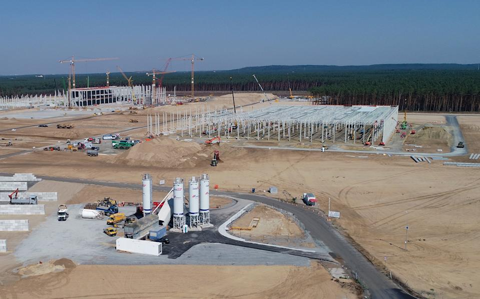 11 August 2020, Brandenburg, Grünheide: View over the construction site with the emerging shell for the future Tesla Giga-Factory (aerial view with a drone). In Grünheide near Berlin, a maximum of 500,000 vehicles per year are to roll off the assembly line from July 2021 - and according to the car manufacturer's plans, the maximum should be reached as quickly as possible. The US electric car manufacturer expects up to 10,500 employees in shift operation for its planned first factory in Europe for the time being. Photo: Patrick Pleul/dpa-Zentralbild/dpa (Photo by Patrick Pleul/picture alliance via Getty Images)