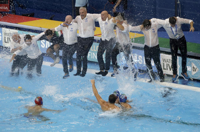 Italian players and mangement celebrate after defeating Spain in their men's water polo gold medal match at the World Swimming Championships in Gwangju, South Korea, Saturday, July 27, 2019. (AP Photo/Mark Schiefelbein)