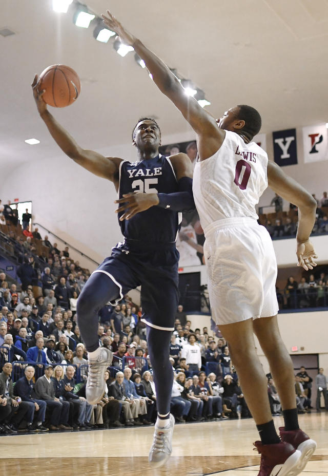 Yale's Miye Oni, left, shoots as Harvard's Chris Lewis, right, defends during the first half of an NCAA college basketball game in a for the Ivy League championship at Yale University in New Haven, Conn., Sunday, March 17, 2019, in New Haven, Conn. (AP Photo/Jessica Hill)